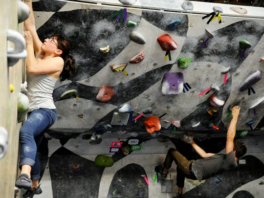 Lisa Weinstock of Harrisburg, left, and Cory Cross of Middletown, right, climb up bouldering walls in Climbnasium Inc in 2013.