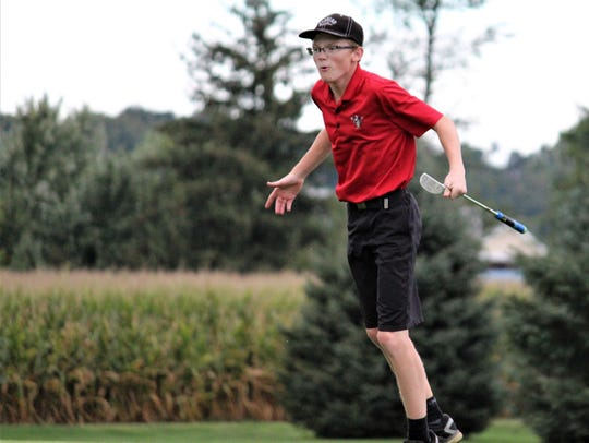 Susquehannock's Andrew Roberts reacts to a putt on