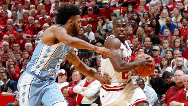 Indiana guard Josh Newkirk dribbles the ball as North Carolina guard Joel Berry II defends during the first half at Assembly Hall.
