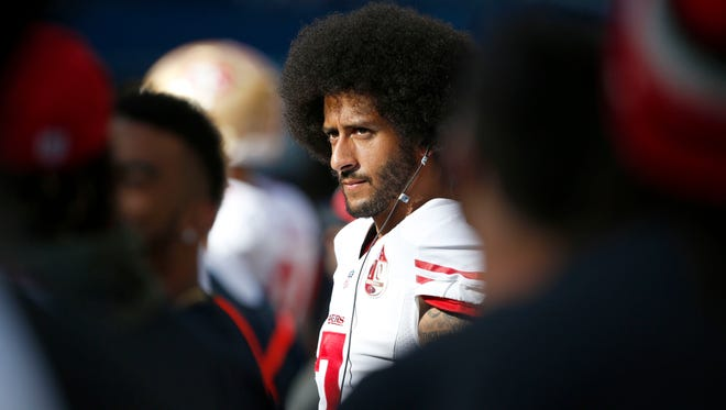 49ers quarterback Colin Kaepernick stands on the sidelines during the fourth quarter of San Francisco's loss to Seattle.