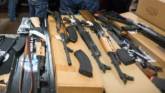 Gun are displayed during gun show at Bektash Shrine Center, Saturday, Jan. 23, 2016, in Concord, New Hampshire.