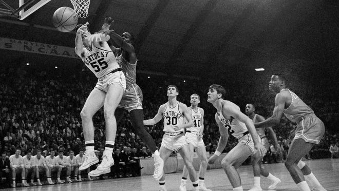 "FILE - In this March 19, 1966, file photo, Kentucky's Thad Jaracz (55) and Texas Western's David Latin (42) reach for a rebound during the first period of the NCAA men's baksetball championship game in College Park, Md. Other Kentucky players shown are Tommy Kron (30) and Larry Conley (40). Fifty years ago, Texas Western started five blacks–Willie Worsley, Orsten Artis, Bobby Joe Hill, David ""Big Daddy"" Lattin and Harry Flournoy–against Kentucky in the game. Today, after reading historical recaps and watching movies, people tend to think it was an immediate watershed moment in sports and civil rights. It wasn't. (AP Photo/File)"