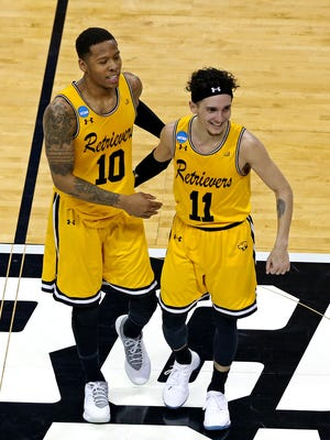 UMBC Retrievers guard Jairus Lyles (10) celebrates with guard K.J. Maura (11) during the second half against the Virginia Cavaliers in the first round of the 2018 NCAA Tournament at Spectrum Center.