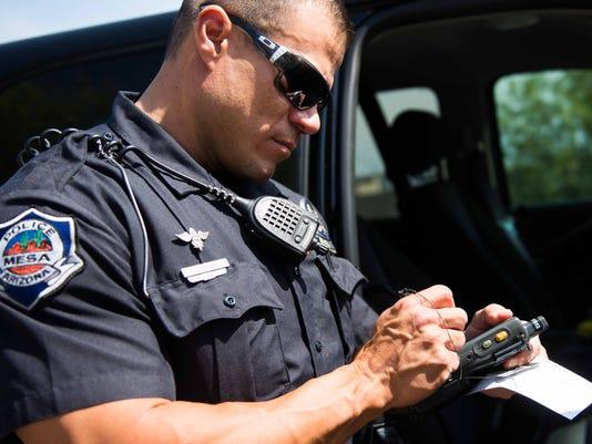 Mesa officer writes traffic ticket