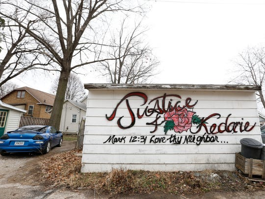 The side of a garage was painted with a memorial for Kedarie Johnson in the alley where he was found dead March 2 in Burlington, Iowa.