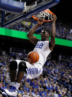 Kentucky Wildcats forward Alex Poythress (22) dunks the ball against the Wright State Raiders in the first half at Rupp Arena.