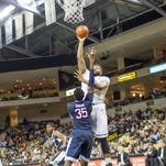 Junior center Justin McBride goes up for a layup against a defending UConn Husky. McBride had four points and three rebounds in his recent effort this past Sunday night, January 31.