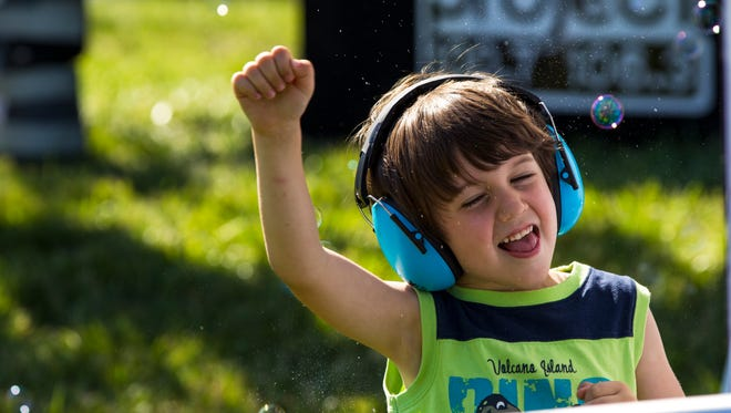 Logan Young, 5, plays in the bubbles near the CVG River stage at the Bunbury Music Festival.