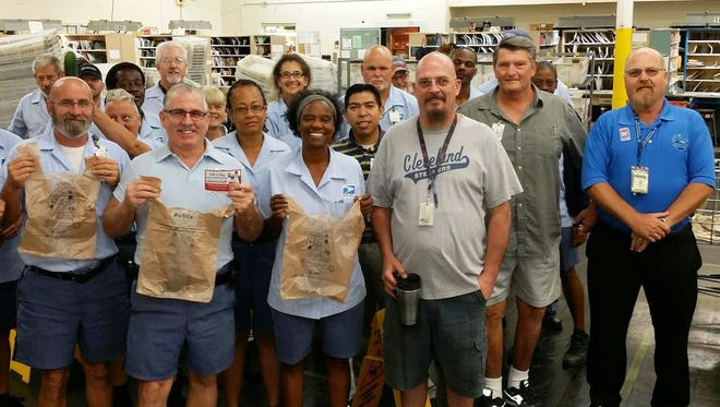 Letter carriers from the Orange Avenue post office in Fort Pierce prepare for the annual Stamp Out Hunger Food Drive.