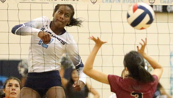 Kayla Ulmer, 12, of Chapin rises for a kill against