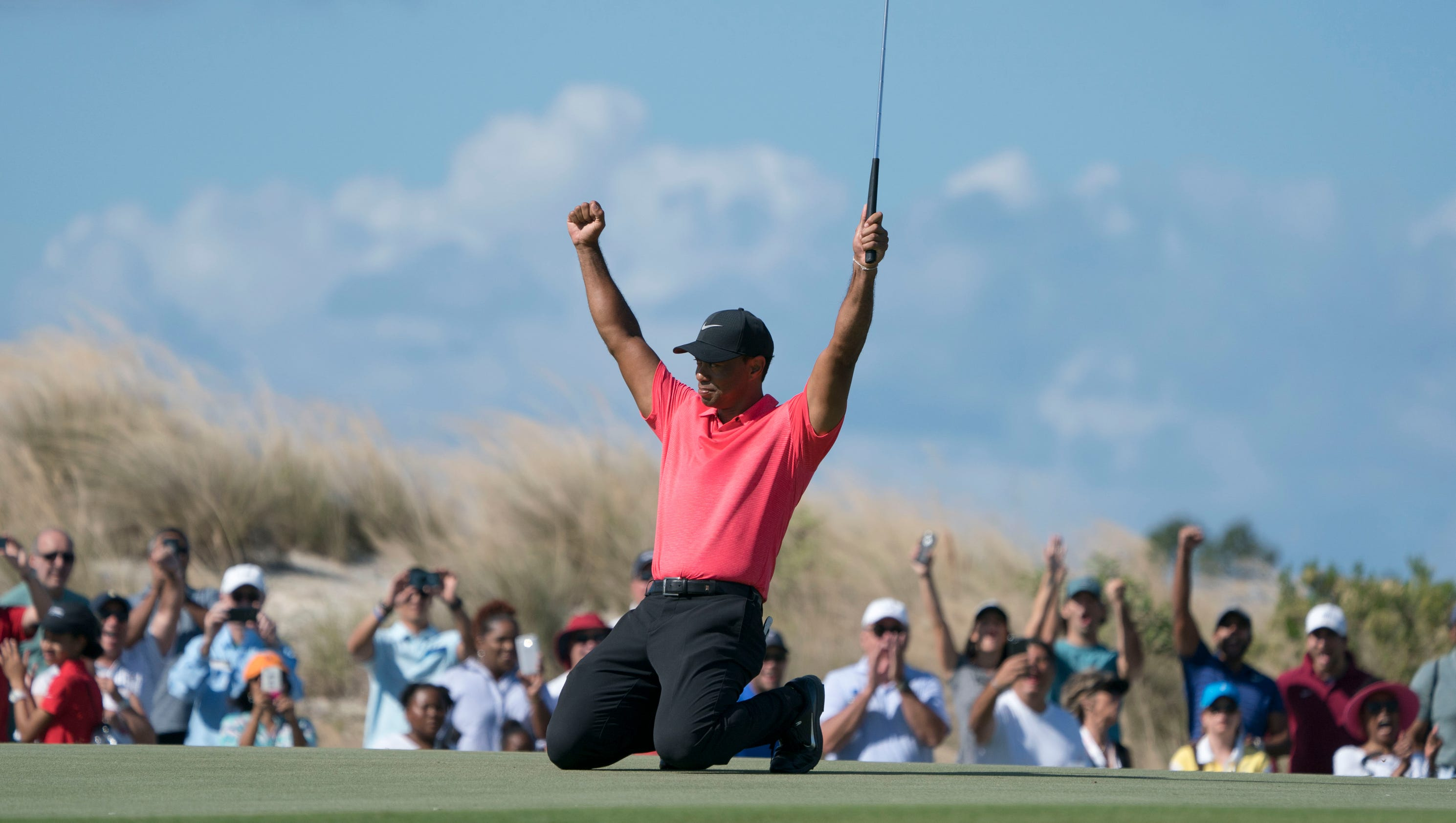 tiger woods is pleased after finishing 8 under at hero