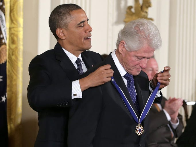President Obama presents the Presidential Medal of Freedom to former president Bill Clinton in the East Room at the White House on Nov. 20 in Washington. The Presidential Medal of Freedom is the nation's highest civilian honor presented to individuals who have made meritorious contributions to the security or national interests of the United States, to world peace or to cultural or other significant public or private endeavors.