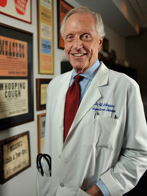 Dr. William Schaffner in his office