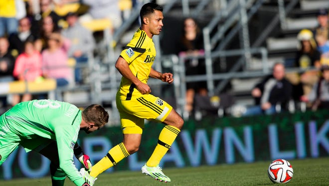 Columbus Crew forward Jairo Arrieta beats Union goalkeeper Zac MacMath for a 13th minute goal.