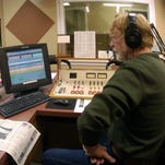 In this 2007 photo, Florida State Sen. Don Gaetz, left, talks with the Luke McCoy and the listeners of WCOA 1370 radio.