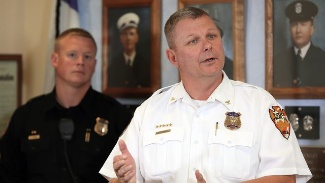 Newark Police Chief Barry Connell speaks to reporters Monday during a press conference held in regards to placing two officers on paid administrative leave pending the results of criminal and internal investigations of unrelated off-duty cases.