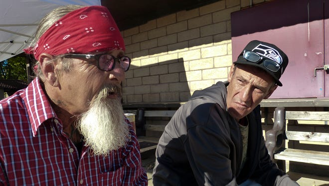 Veterans Rocky Fredrick, left, and Tom Street, share a quiet moment at last year's North Valley Stand Down at the Shasta District Fair grounds in Anderson.