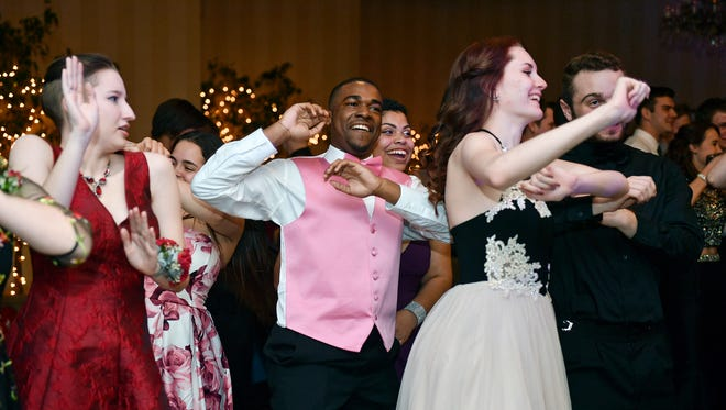 Students and their guests attend Northeastern's prom Saturday, April 14, 2018, at Out Door Country Club in Manchester Township.