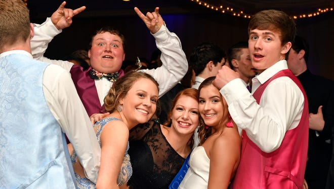 Students and their guests attend Dover's prom Saturday, April 28, 2018, at Out Door Country Club in Manchester Township.