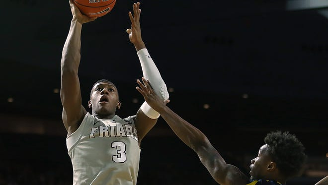 By most estimates, Kris Dunn (left) is the best player in college basketball.