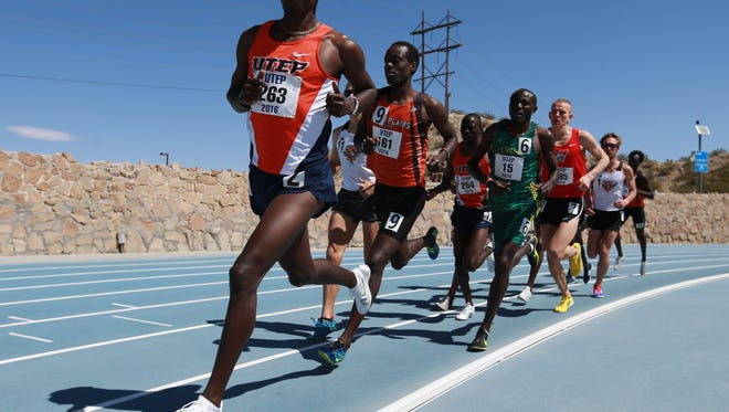 UTEP'S Cosmas Boit, left, leads the pack as runners in this file photo.