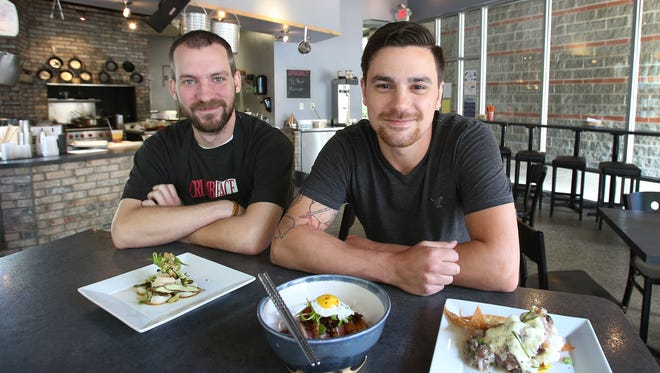 Mirin chef Griffin Paulin, right, and sous chef Gabe Huber, left.