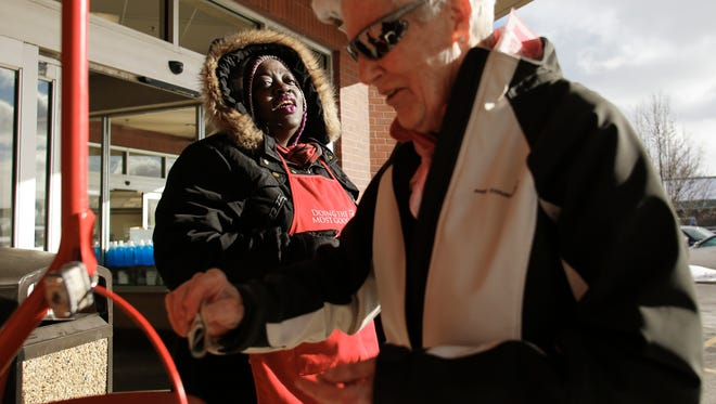 """""""Anna makes my day, she's always singing, she laughs a lot, and she always has a smile on her face,"""" Ellen Lunden of Delta Township said after putting money in Salvation Army bell ringer Anna Diamond's kettle, Tuesday, Dec. 12, 2017.  Diamond is one of the Lansing area's top collectors, and has become a sort of fixture at the Kroger on Lansing's west side during the holiday season."""
