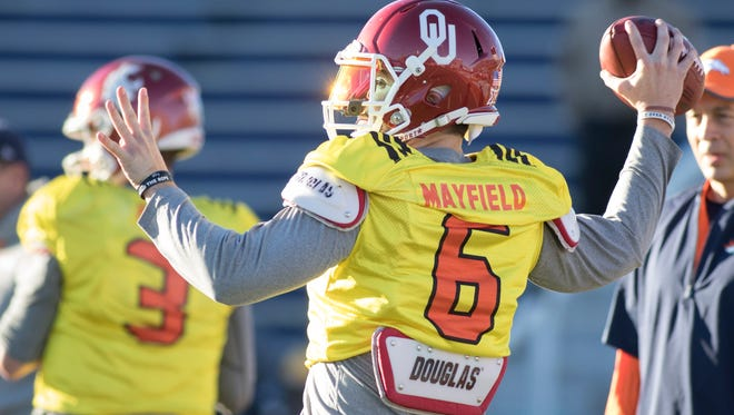 Oklahoma quarterback and Heisman winner Baker Mayfield (6) gets set to pass during practice for the Senior Bowl in Mobile, Alabama on Tuesday, January 23, 2018.