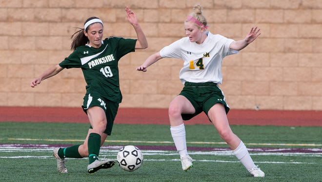 Parkside's Blair Vilov (19) attempts to move the ball around Queen Anne's Meagan Lukehart (14) in the Bayside Championship at Washington College in Chestertown on Monday, Oct. 26.