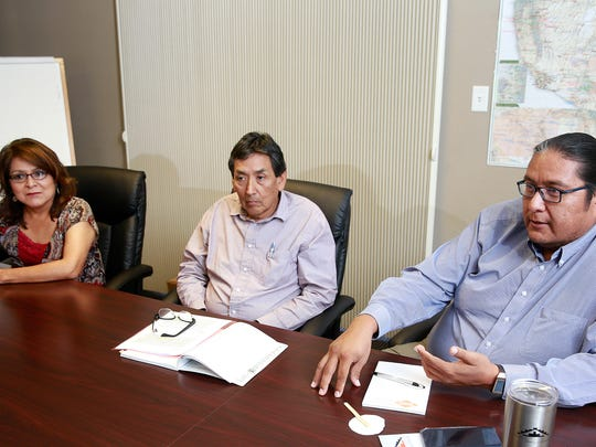 From left: Melissa Kelly, Steve Grey and Erny Zah on Monday discuss NTEC's securing of a loan to pay off the loan from BHP Billiton New Mexico that was used to purchase the Navajo Mine.