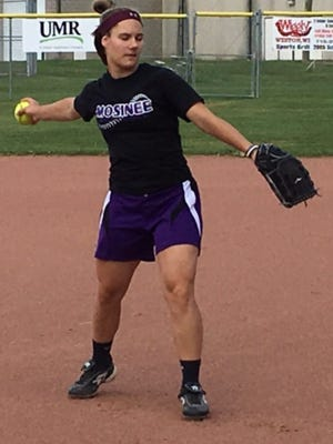 Mosinee.  junior pitcher Sydni Guburek warms up before the start of practice on Monday