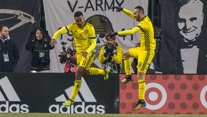 Columbus Crew SC forward Ola Kamara (11) celebrates his goal with forward Justin Meram (9) in the first half against the New York City FC at MAPFRE Stadium.