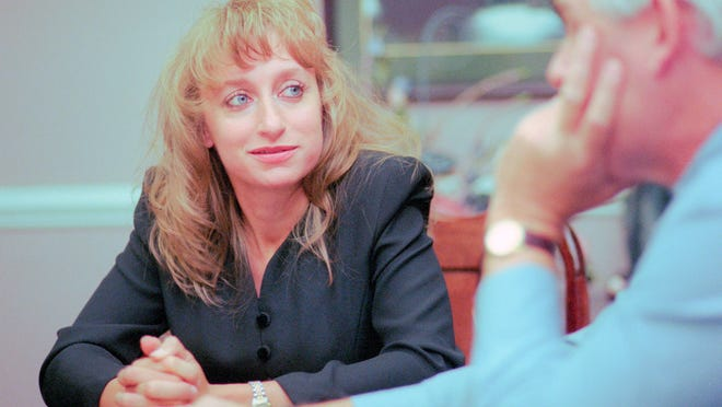 Former University of Tennessee athletic trainer Dr. Jamie Whited, 28, looks to her attorney Jim Andrews during an interview Friday, Aug. 22, 1997. Whited was paid $300,000 by UT to settle a 33-item complaint detailing allegations of sexual harassment. (NEWS SENTINEL ARCHIVE)