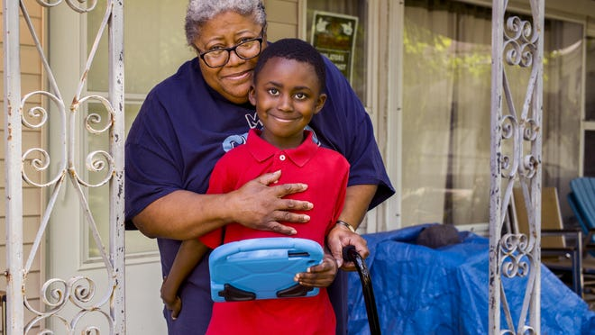 Rafel Marizetts, 6, stands wrapped in the arms of his mother, Idella Marizetts, 73, at their home on W. Harvard Ave. in Peoria Thursday, July 16, 2020. Idella Marizetts has leukemia and has decided not to send Rafel, who she adopted when he was 5 days old, to school in the fall because of the risks of COVID-19 exposure for both of them. The decision to allow children to return to school is especially difficult for older caregivers who are more susceptible to COVID-19.