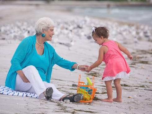 Nancy Schlossberg plays with her granddaughter Stevie, 2, at Longboat Key, Fla.