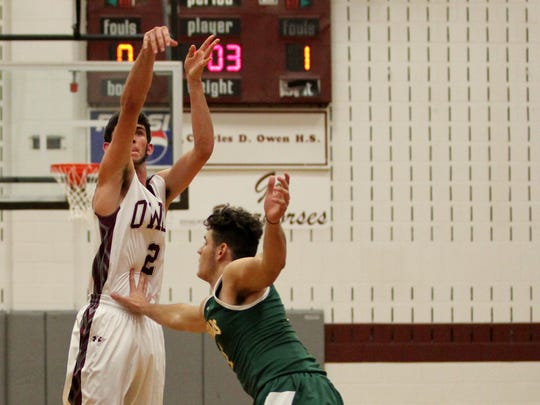Brian Bartlett shoots over a Reynolds defender in the Warhorses 73-72 victory over the Rockets on Dec. 5.