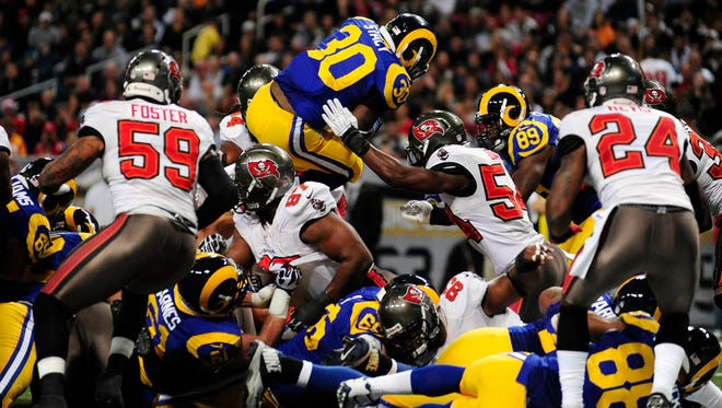 St. Louis Rams running back Zac Stacy (30) leaps into the end zone for a one yard touchdown during the first half against the Tampa Bay Buccaneers at the Edward Jones Dome.