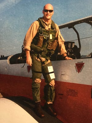 In this undated photo provided by the Norgren family, Marine Capt. Chris Norgren poses for a photo when he was in Navy flight school.