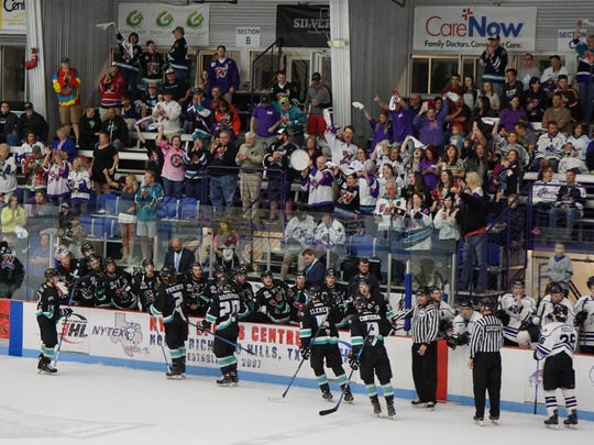 The Shreveport Mudbugs bench and fans celebrate a goal in the third period Saturday.