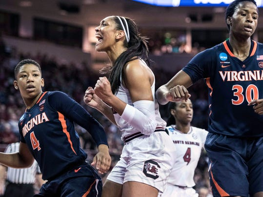 South Carolina forward A'ja Wilson, center, celebrates a basket against Virginia guard Dominique Toussaint (4) and Felicia Aiyeotan (30) during the first half of a game in the second-round of the NCAA women's college basketball tournament, Sunday, March 18, 2018, in Columbia, S.C. (AP Photo/Sean Rayford)