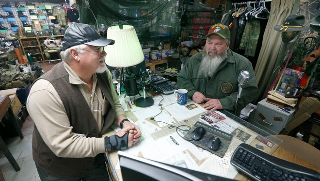 Veteran Dave Silver of Geneva who was a Specialist 4 in Vietnam, talks to Military Exchange store owner Tim Thornton, in Canandaigua, Ontario County.
