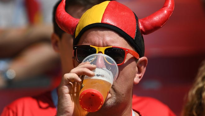 A Belgium fan drinks a beer ahead of the Russia 2018 World Cup Group G football match between Belgium and Tunisia at the Spartak Stadium in Moscow on June 23, 2018.