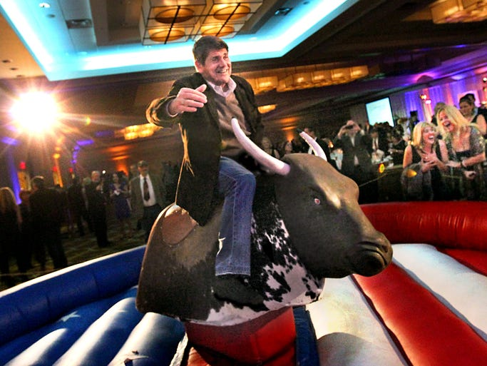 Ride'em Jeff !!! Emmis Communications Corp. chairman and CEO Jeff Smulyan tries his hand at the mechanical bull at the 2013 the American Cancer Society Indianapolis Discovery Ball, Nov.15 at the Westin Hotel in Downtown Indy.