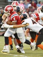 Glenn ball carrier Khalil McDaniel (4) tries to break