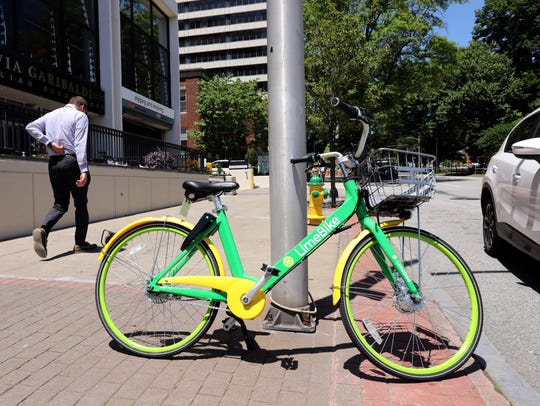 A LimeBike, which is part of the dockless bike sharing