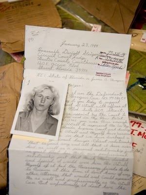 A photo of James Morgan, who was 16 when he killed 66-year old widow, Gertrude Trbovich, in Stuart in 1977, is seen Aug. 22, 2016, at the Martin County Courthouse, with a letter he wrote and other evidence used in his original murder conviction and subsequent appeals.