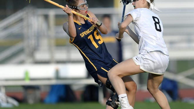 Spencerport's Camryn Sack, left, is defended by Rush-Henrietta's Courtney Rowe during a regular season game at Rush-Henrietta High School on Wednesday, May 9, 2018. Rush-Henrietta beat Spencerport 18-9.