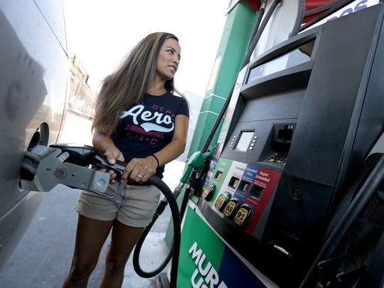 Hannah Quiroz fills her vehicle's tank Thursday at the Murphy USA gas station outside the Walmart Neighborhood Market at Pebble Hills Boulevard and Saul Kleinfeld Drive, where gas was selling for $1.87 per gallon, one of the lowest prices in El Paso.