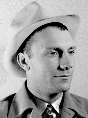 Press photo of Arizona State Teachers College coach Dixie Howell in 1941 taken prior to the team's appearance in the 1941 Sun Bowl in El Paso, Texas