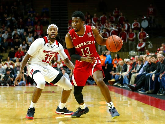 Nebraska Cornhuskers guard Anton Gill (13) drives to